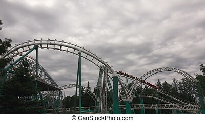 Roller coaster. Attraction. Shot in 4K (ultra-high...