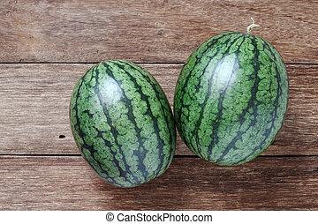 watermelon full put on wood floor