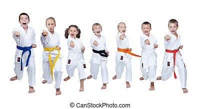 Children in karategi beats blows - A group of children in...