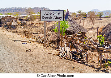 Road sign to Derek Abay village in Ethiopia. - View at the...