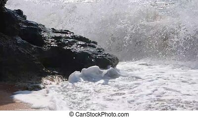 Dangerous waves in slow motion Ocean surf over the cliff