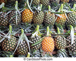 A lot of fresh pineapple fruit background