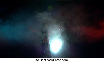 Movements of beautiful woman finishing belly dance in blue...