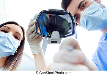 Cute young woman at the dentist. Mouth checkup