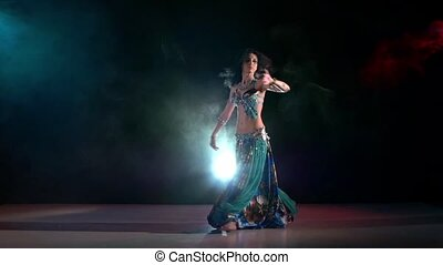 Exotic belly dance movements of young and attractive girl in...