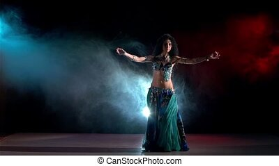 Sensetive belly dance movements of young and attractive girl...
