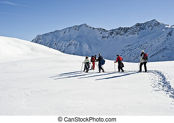 on tour - group on snowshoes at the Alpes in Austria in...