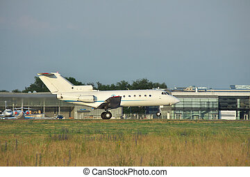 Plane takeoff - Regional or business jet is taking off from...