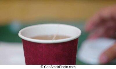 Dip teabag in take-away cup full of hot water.