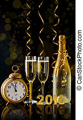 2016 New Year concept with two champagne glasses ready to...