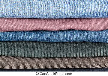 stack of different denims close up - stack of different...