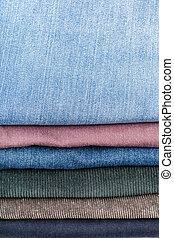 stack of various jeans close up - stack of various jeans and...