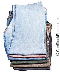 top view of stack of various jeans and corduroys isolated on...