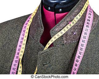 tailoring of collar for tweed jacket on mannequin isolated...
