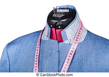 tailoring of man blue silk jacket on dummy isolated on white...