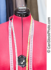 mannequin with measure tapes and tissues - red tailor dummy...