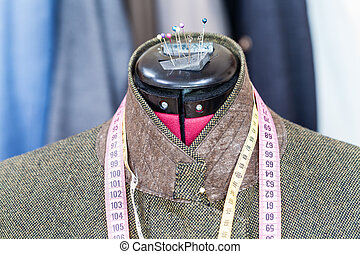 tweed jacket on mannequin and ready suits - tailoring of...