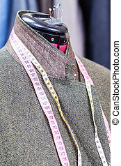 woolen tweed jacket on dummy and ready suits - tailoring of...