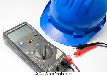 Helmet and multimeter isolated - Isolated blue helmet and...