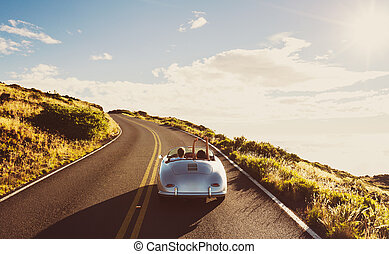 Coupe Driving on Country Road in Vintage Sports Car - Happy...
