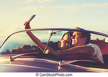 Couple Taking a Selfie in Car at Sunset - Romantic Young...