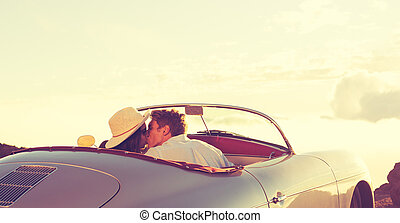Couple Kissing in Classic Vintage Sports Car - Romantic...