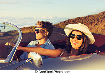 Young Couple in Classic Vintage Sports Car - Happy Young...