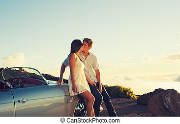 Couple Watching the Sunset and Kissing with Classic Vintage...