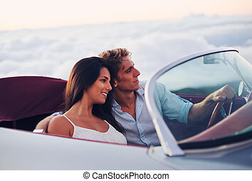 Couple Watching the Sunset in Classic Vintage Car - Romantic...