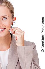 Close-up of a smiling businesswoman using headset