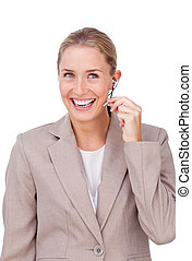 Radiant blond businesswoman using headset