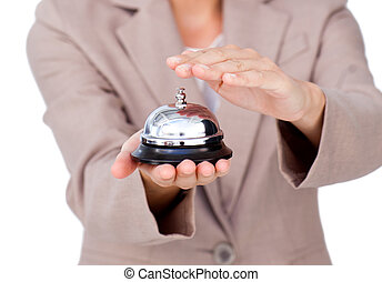Close-up of a businesswoman using service bell against a...