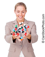 Assertive businesswoman showing a molecule