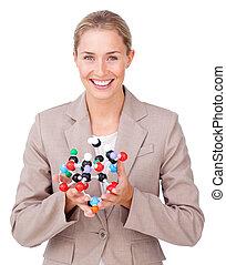 Confident businesswoman showing a molecule