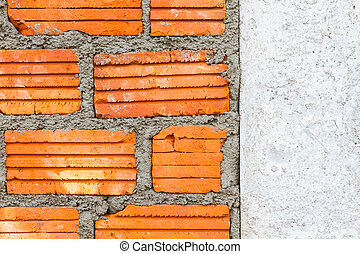closeup brick wall with wet layer concrete and dry white wall on the right.