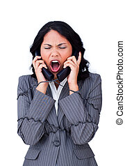 Vexed businesswoman tangled up in phone wires