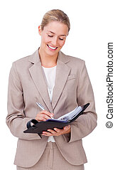 Self-assured businesswoma holding a notes isolated on a...