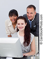 Multi-ethnic Business partners working together at a computer