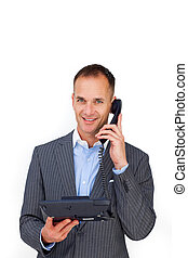 Smiling businessman using a phone