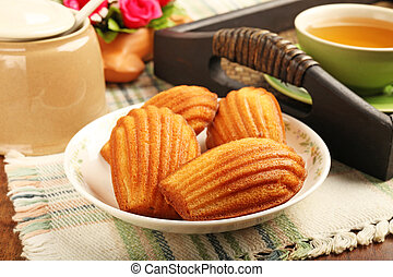 Madeleine cookie and cup of tea.