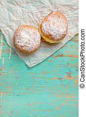 Sweet sugary donuts on rustic table - Sweet sugary donuts on...