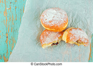 Sweet sugary donuts on rustic table - Sweet sugary donuts...