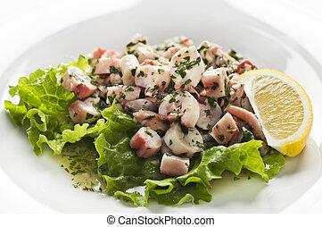 Octopus salad - Fresh octopus salad with lemon close up...
