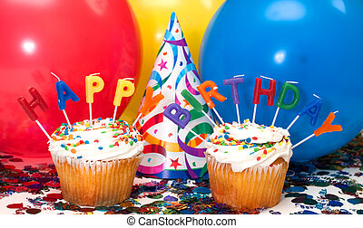 Birthday Party - Birthday party with cupcakes, candles,...