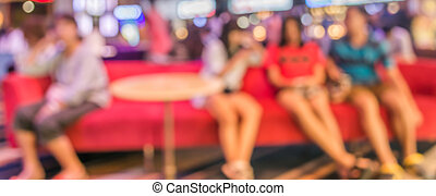 girl group sit on red sofa