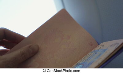 Looking through the passport - Slow motion and close-up shot...
