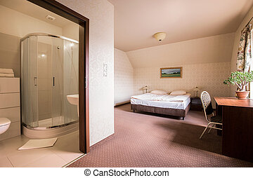 Roomy bedroom and bathroom in the hotel