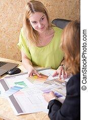 Interior designer choosing color - Interior designer...