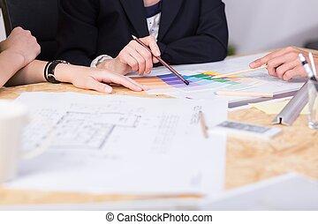 Interior designer working - Close-up of interior designer...