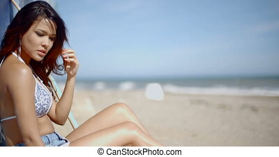 Slow Motion of Beautiful Girl Sitting on The Beach - Slow...